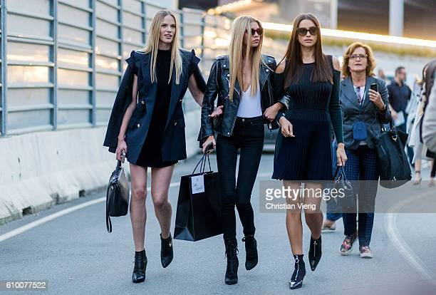 Models Anne Vyalitsyna Stella Maxwell and Irina Shayk outside Versace during Milan Fashion Week Spring/Summer 2017 on September 23 2016 in Milan Italy