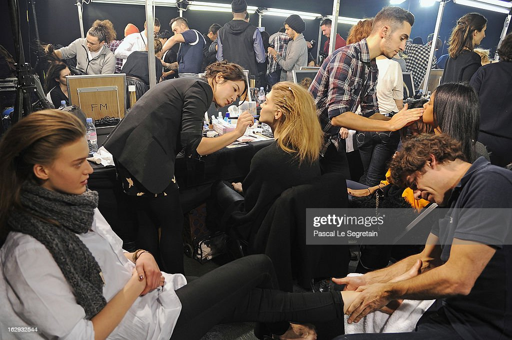 Models are being made up, rear, as another is given a foot massage (L), backstage prior to the Sonia Rykiel Fall/Winter 2013 Ready-to-Wear show as part of Paris Fashion Week at Halle Freyssinet on March 1, 2013 in Paris, France.
