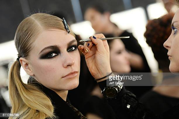 Models are prepared backstage ahead of the DAKS show during London Fashion Week Autumn/Winter 2016/17 at The Langham Hotel on February 19 2016 in...