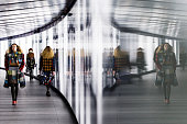 Models are reflected on the runway during the Preen by Thornton Bregazzi show during London Fashion Week Fall/Winter 2015/16 on February 24 2015 in...