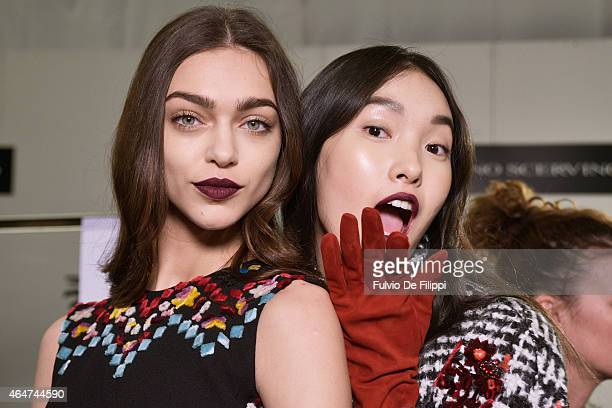 Models are seen backstage ahead of the Ermanno Scervino show during the Milan Fashion Week Autumn/Winter 2015 on February 28 2015 in Milan Italy