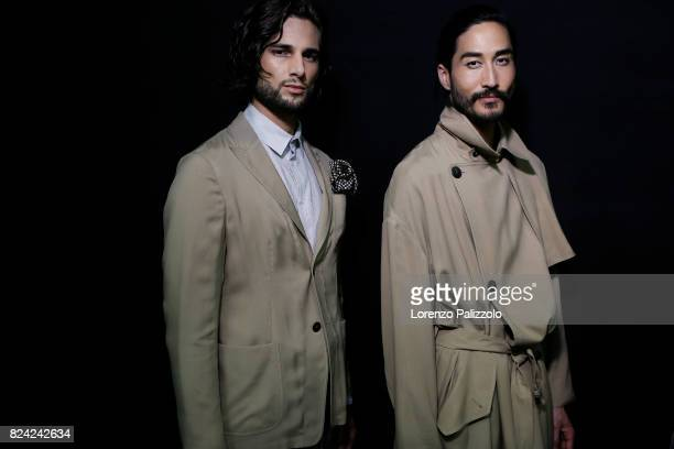Models are seen backstage ahead of the Giorgio Armani show during Milan Men's Fashion Week Spring/Summer 2018 on June 19 2017 in Milan Italy