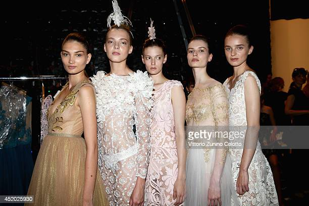 Models are seen backstage ahead of the Irene Luft show during the MercedesBenz Fashion Week Spring/Summer 2015 at Erika Hess Eisstadion on July 11...