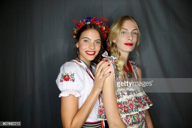 Models are seen backstage ahead of the Lena Hoschek show during the MercedesBenz Fashion Week Berlin Spring/Summer 2018 at Kaufhaus Jandorf on July 4...