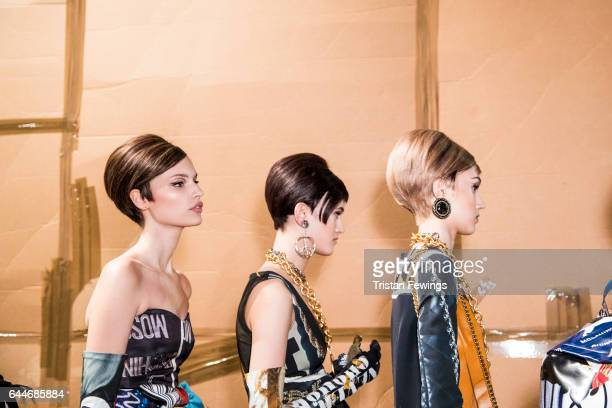 Models are seen backstage ahead of the Moschino show during Milan Fashion Week Fall/Winter 2017/18 on February 23 2017 in Milan Italy