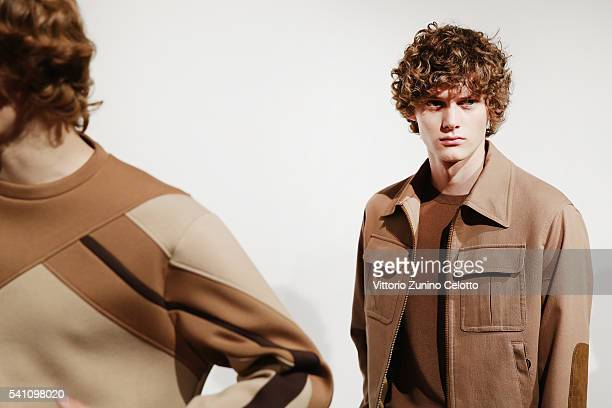 Models are seen backstage ahead of the Neil Barrett show during Milan Men's Fashion Week Spring/Summer 2017 on June 18 2016 in Milan Italy