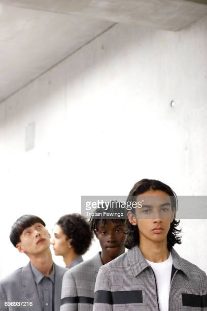 Models are seen backstage ahead of the Neil Barrett show during Milan Men's Fashion Week Spring/Summer 2018on June 17 2017 in Milan Italy