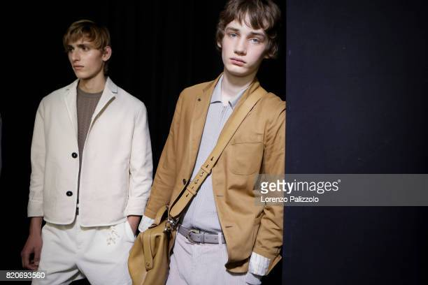Models are seen backstage ahead of the Salvatore Ferragamo show during Milan Men's Fashion Week Spring/Summer 2018on June 18 2017 in Milan Italy