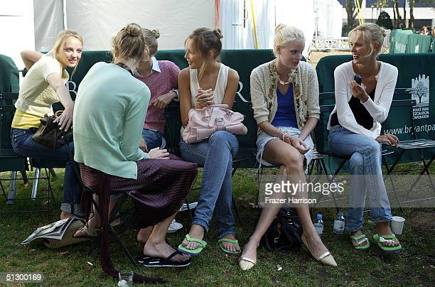 Models are seen backstage at the Oscar De La Renta Spring 2005 fashion show during the Olympus Fashion Week Spring 2005 at Bryant Park September 13...