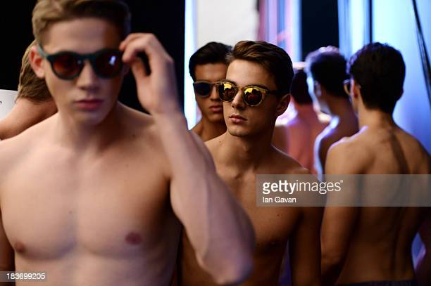 Models are seen backstage at the Serdar Uzuntas show during MercedesBenz Fashion Week Istanbul s/s 2014 presented by American Express on October 9...