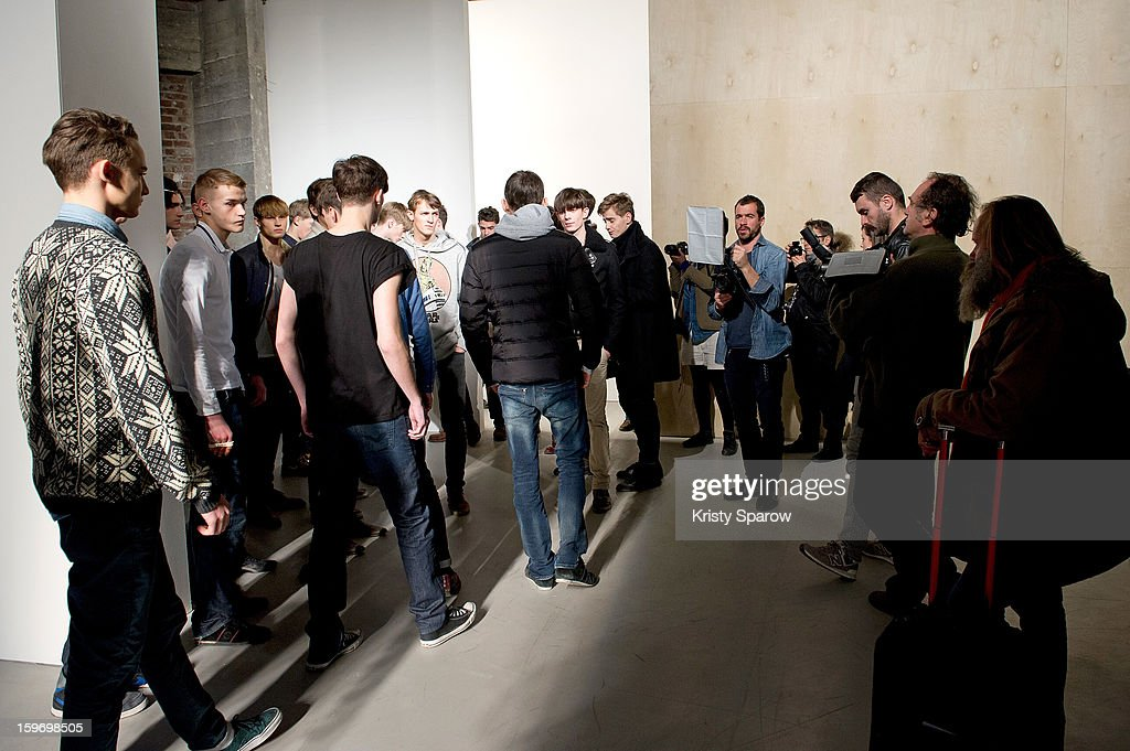 Models are seen backstage before the Krisvanassche Menswear Autumn / Winter 2013/14 show as part of Paris Fashion Week on January 18, 2013 in Paris, France.