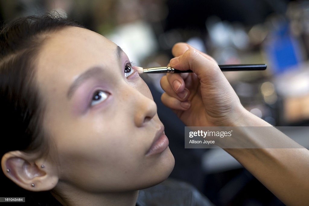 Models are seen backstage before the Tocca fall 2013 presentation during Mercedes-Benz Fashion Week at the Baryshnikov Arts Center on February 8, 2013 in New York City.