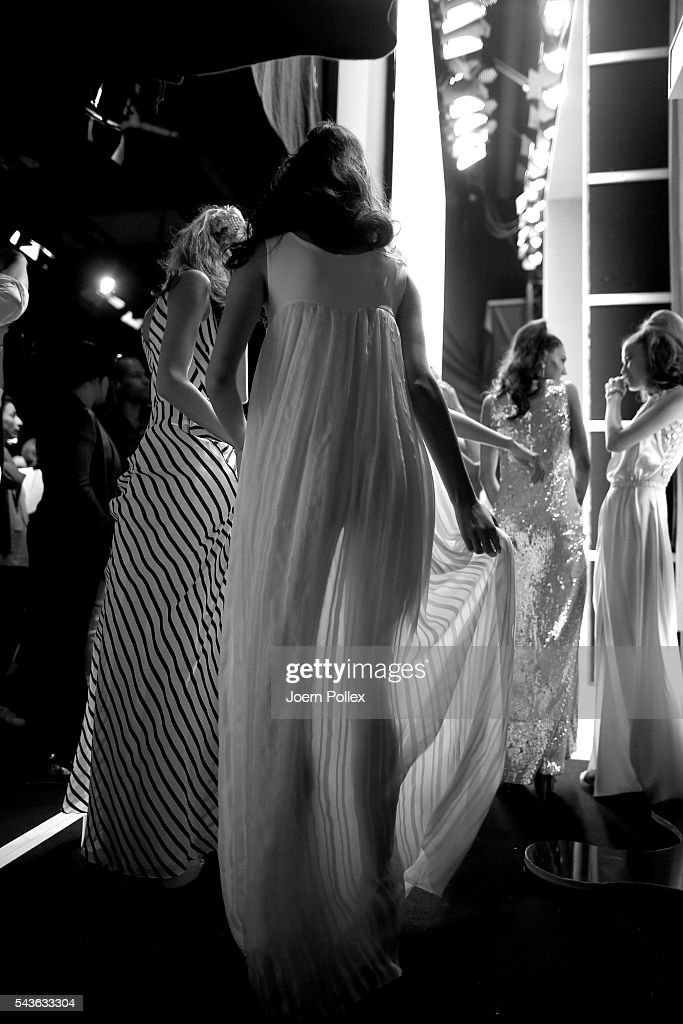 Models are seen backstage during the Guido Maria Kretschmer show during the Mercedes-Benz Fashion Week Berlin Spring/Summer 2017 at Erika Hess Eisstadion on June 29, 2016 in Berlin, Germany.