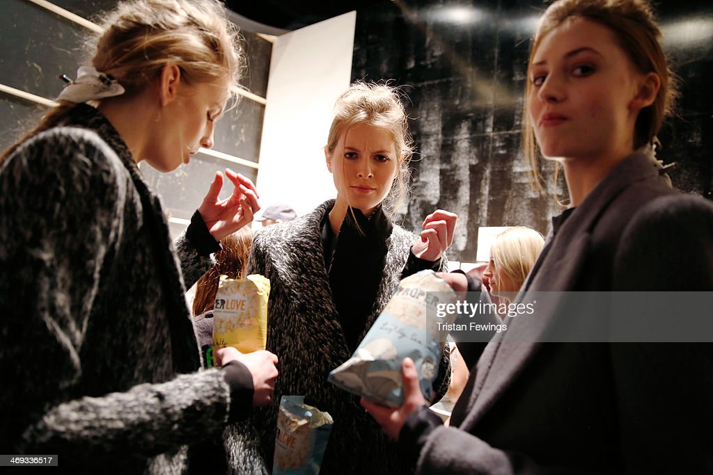 Models are seen backstage prior to the Haizhen Wang presentation at London Fashion Week AW14 at Somerset House on February 14 2014 in London England