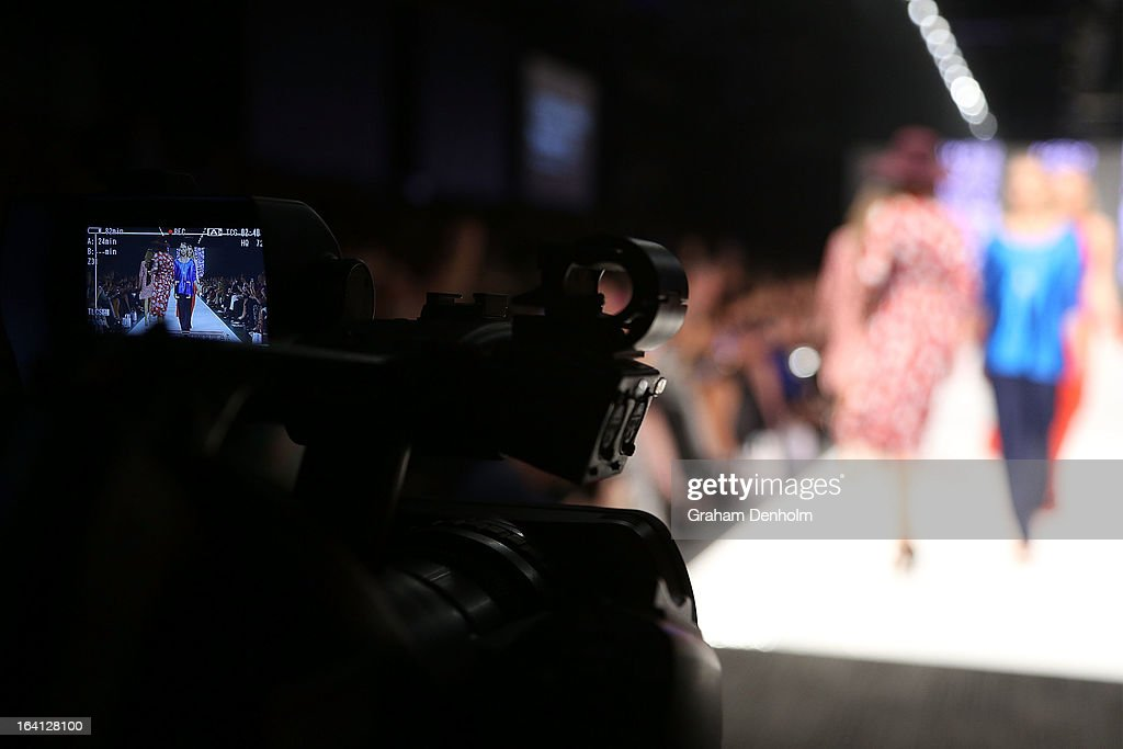 Models are seen walking the finale through the screen of a video camera during L'Oreal Paris Runway 2 during day three of L'Oreal Melbourne Fashion Festival at Docklands on March 20, 2013 in Melbourne, Australia.