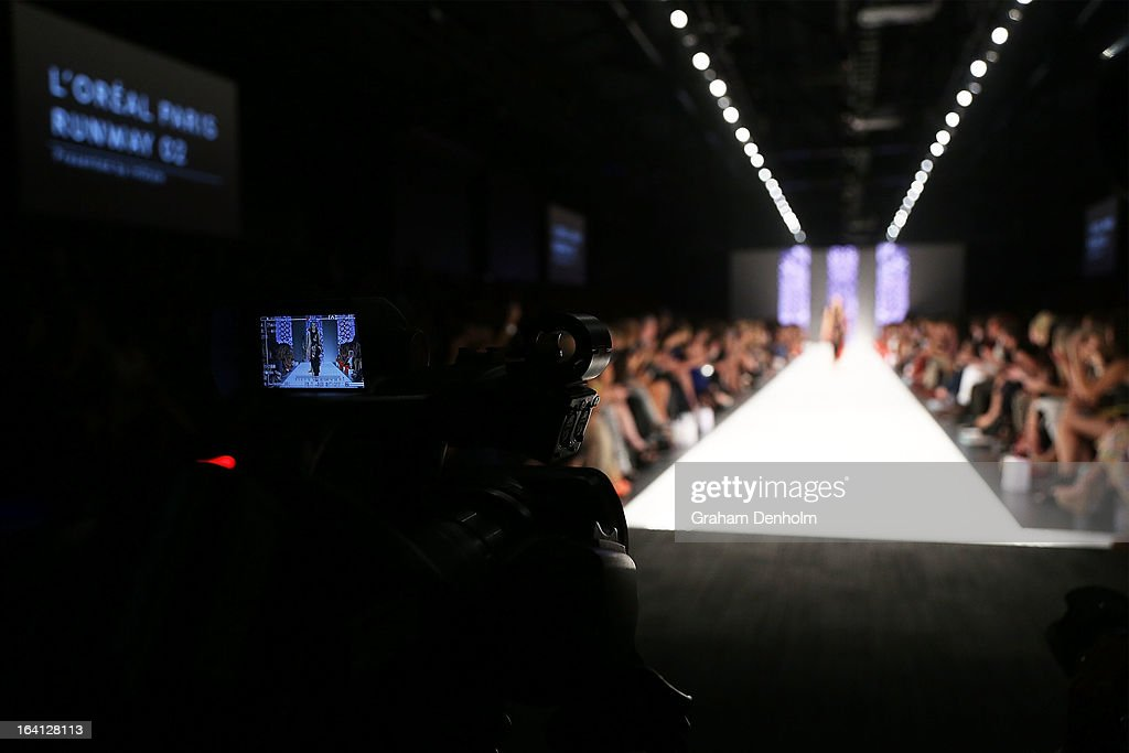 Models are seen walking the finale through the screen of a video camera during L'Oreal Paris Runway 2 during day three of L'Oreal Melbourne Fashion...