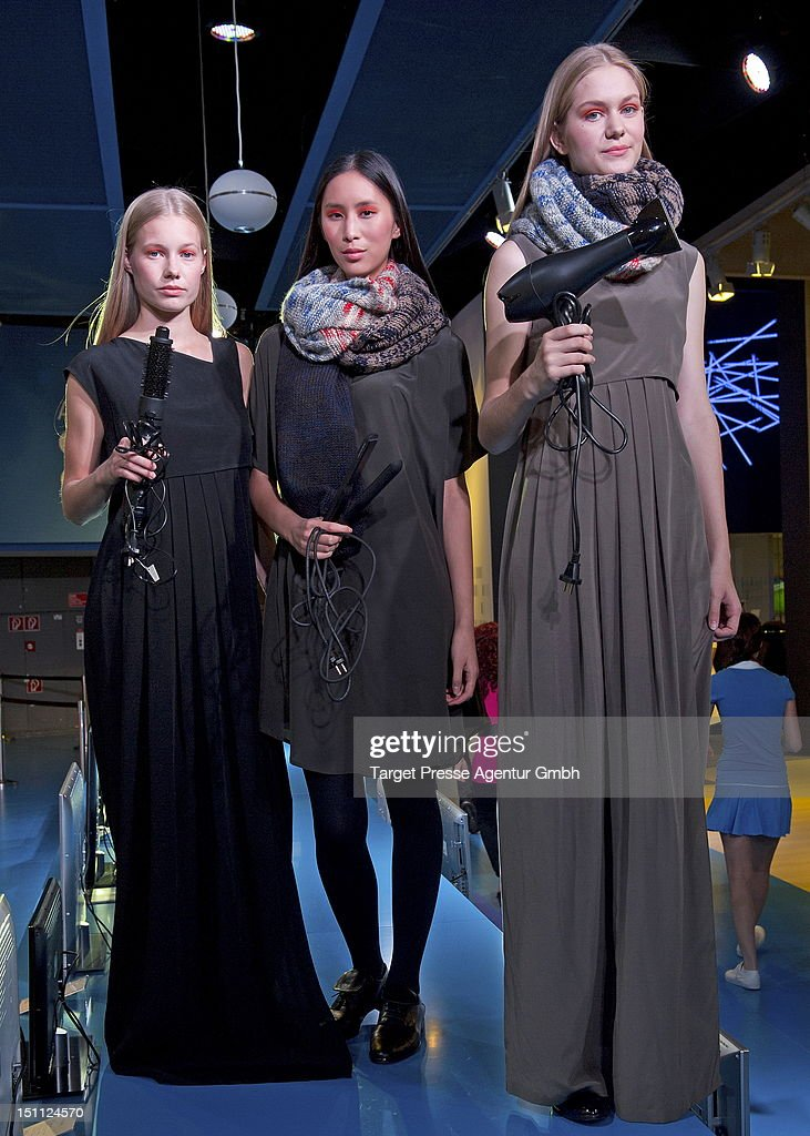 Models are styled with Grundig products during the Kilian Kerner and Grundig fashion show at the 'Internationale Funkausstellung' on September 1, 2012 in Berlin, Germany.