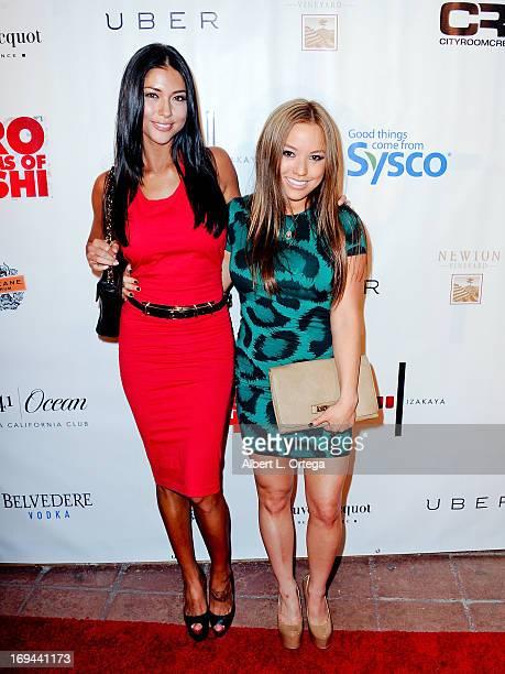 Models Ashley Villa and Arianny Celeste arrive for the Bamboo Izakaya Restaurant Grand Opening on May 9 2013 in Santa Monica California
