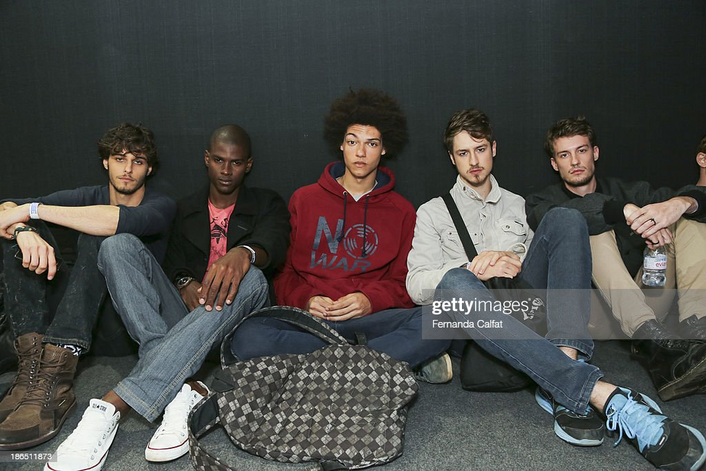 Models atend backstage a the Colcci show at Sao Paulo Fashion Week Winter 2014 on October 31, 2013 in Sao Paulo, Brazil.