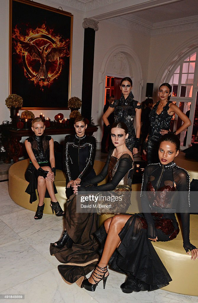 Models attend Lionsgate's 'The Hunger Games: Mockingjay Part 1' party at a private villa on May 17, 2014 in Cannes, France.