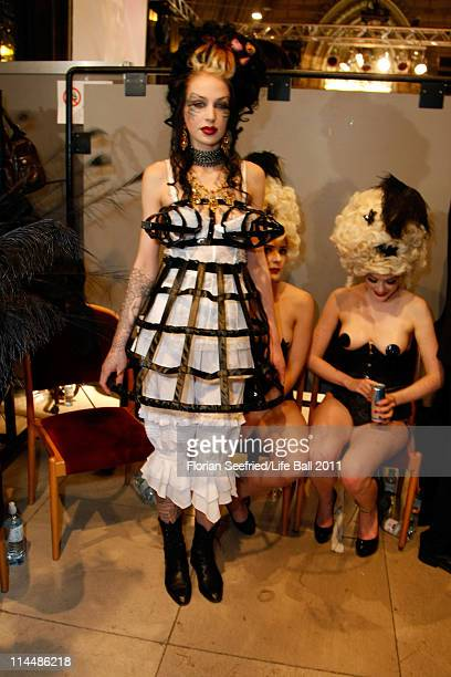 Models attend the 19th Life Ball backstage at the Town Hall on May 21 2011 in Vienna Austria