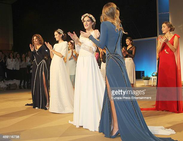 Models attend the debut as designers of Lourdes Montes and Sibi Montes at Palacio de Exposiciones y Congresos on November 14 2014 in Seville Spain