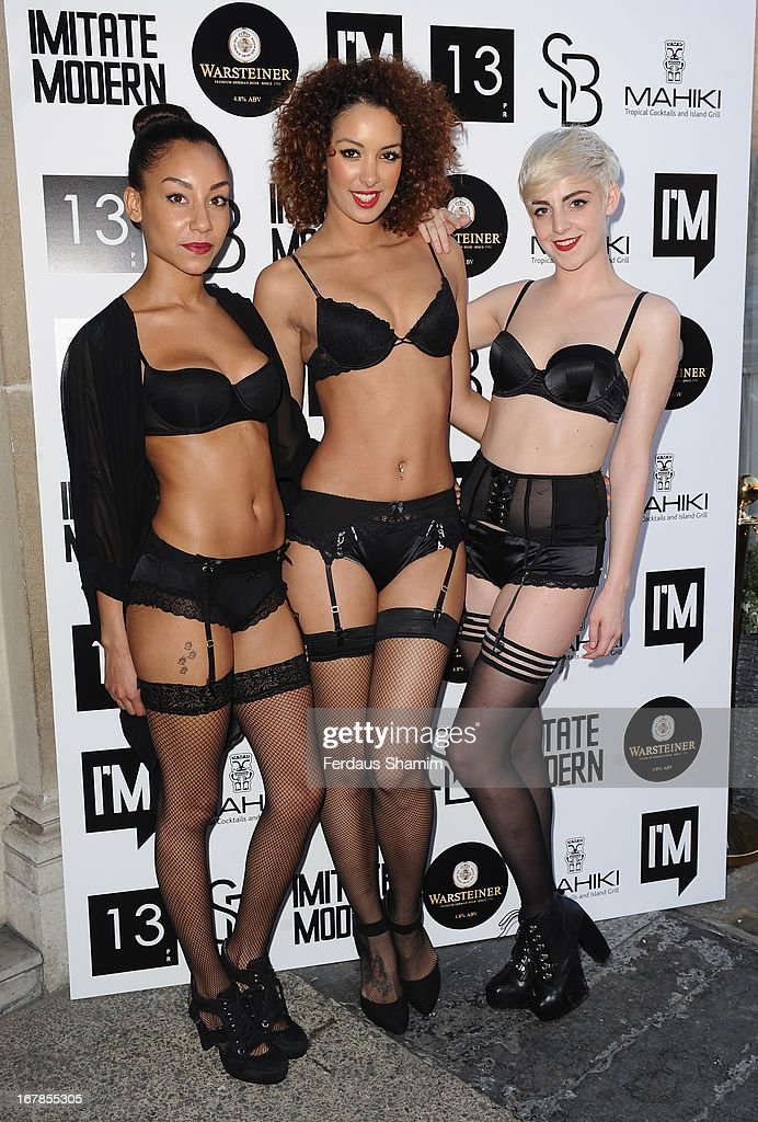 Models attend the Human Relations private view at Imitate Modern on May 1, 2013 in London, England.