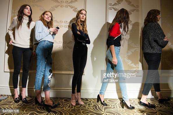 Models backstage ahead of the DAKS show at the Langham Hotel during London Fashion Week February 2017 collections on February 17 2017 in London...