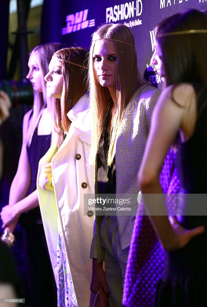 Models backstage ahead of the Dimitri show during Mercedes-Benz Fashion Week Spring/Summer 2014 at Brandenburg Gate on July 3, 2013 in Berlin, Germany.