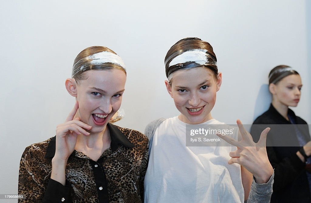 Models backstage at the Louise Goldin fashion show during MADE Fashion Week Spring 2014 at Milk Studios on September 7, 2013 in New York City.
