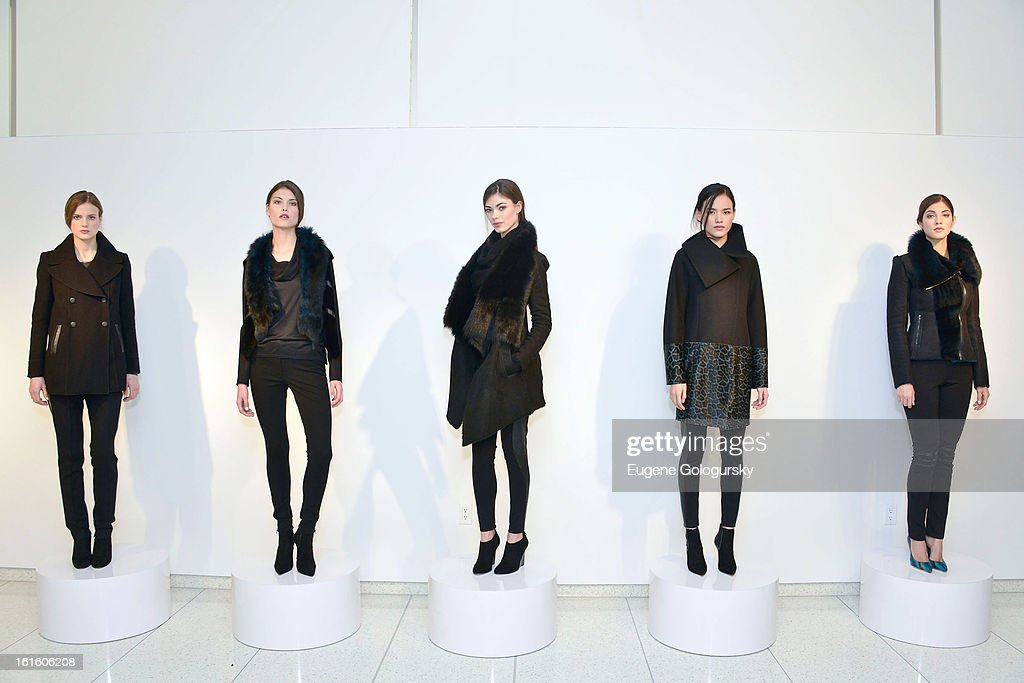 Models backstage attend Elie Tahari during Fall 2013 Mercedes-Benz Fashion Week on February 12, 2013 in New York City.