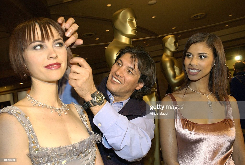 Models backstage get their hair styled by Frederic Fekkai (C) at the 2003 Oscar Fashion Preview at the Kodak Theatre on March 4, 2003 in Hollywood, California.