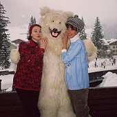 Models Barbara Mullen and Dorian Leigh posing with a friend in a polar bear costume at Klosters ski resort