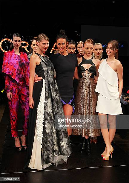 Models Barbara Palvin and Megan Gale pose on the runway during the L'Oreal Paris Luncheon on day one of L'Oreal Melbourne Fashion Festival on March...