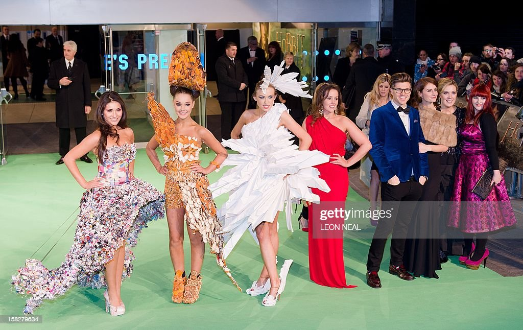 Models Bebhinn Sheridan (L), Katie Brill (2-L) and Sam Madden (3L) stand with Junk Kouture founder Elizabeth O'Donnell (4-L), tv presenter Darren Kennedy (4-R), model Faye Dinsmore (3-R), ERP Ireland's Yvonne Holmes (2-R) and art tutor Sinead Fahey (R) at the European premiere of the first in the new trilogy of films based on the work of J R R Tolkien, 'The Hobbit: An Unexpected Journey' in Leicester Square, central London on December 12, 2012. AFP PHOTO/Leon Neal