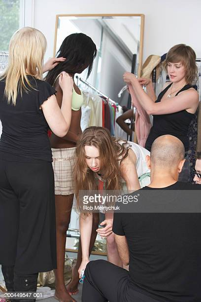 Models being dressed and styled backstage at fashion show