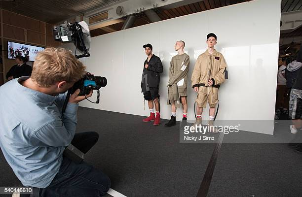 Models being photographed backstage ahead of the Liam Hodges show during The London Collections Men SS17 at BFC Show Space on June 13 2016 in London...
