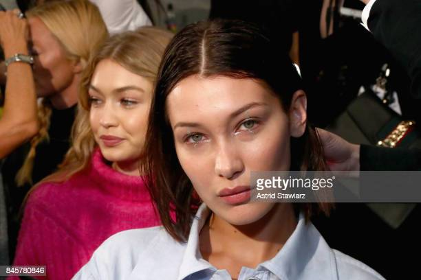 Models Bella Hadid and Gigi Hadid prepare backstage for Anna Sui fashion show during New York Fashion Week The Shows at Gallery 1 Skylight Clarkson...