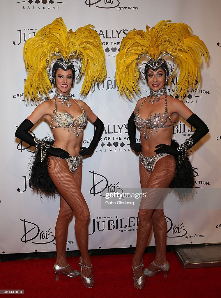 Models Brittany Guinane (L) and Taryn Olivieri arrive at the 'Jubilee' show's grand re-opening at Bally's Las Vegas on March 29, 2014 in Las Vegas, Nevada.