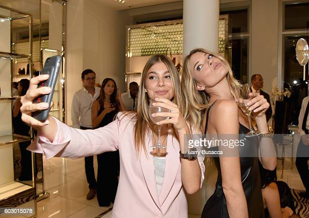 Models Cami Morrone and Martha Hunt attend the Michael Kors Access Smartwatch launch party at Michael Kors on September 11 2016 in New York City