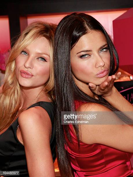 Models Candice Swanepoel and Adriana Lima attend Victoria's Secret Beauty 'Bombshell' fragrance launch at Victoria's Secret SoHo on September 24 2010...