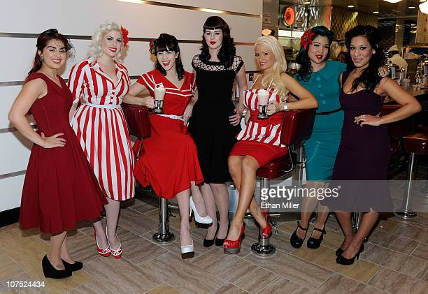 Models Carla Avila Doris Mayday Claire Sinclair Molly Kaiser Holly Madison Crystal Taylor and Alex Garcia appear in Bettie Page style dress at Johnny...
