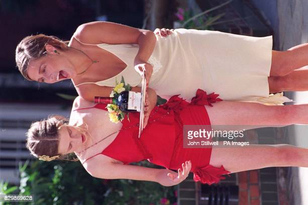 Models Christine Latham and Annabel Laister laugh after spilling glasses of Courvoisier cognac from the tray they are carrying during a photocall in...