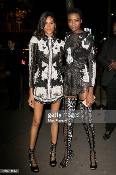 Models Cindy Bruna and Maria Borges arrive to attend the 'L'Oreal Paris X Balmain' party on September 28 2017 in Paris France