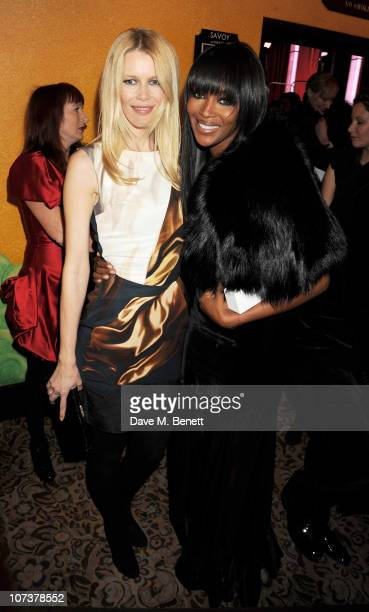 Models Claudia Schiffer and Naomi Campbell pose at the British Fashion Awards 2010 at The Savoy Hotel on December 7 2010 in London England