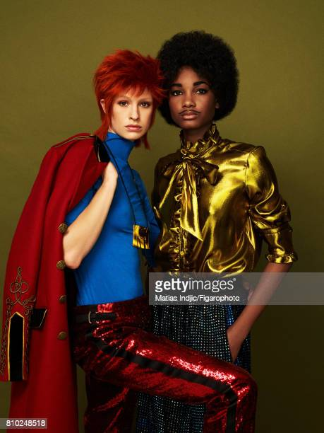 Models pose as David Bowie and Prince at a fashion shoot for Madame Figaro on May 10 2017 in Paris France Coat top pants necklace Blouse pants...