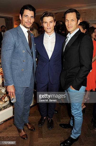 Models David Gandy Oliver Cheshire and Paul Sculfor attend the Jimmy Choo Esquire London CollectionsMen opening night party at Loulou's 5 Hertford...