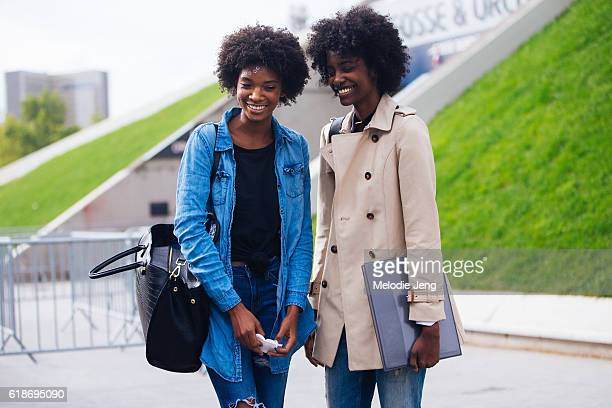 Models Derrionna Rogers and Crystal Noriega in circular makeup by Alex Box after the Issey Miyake show on September 30 2016 in Paris France Derionna...
