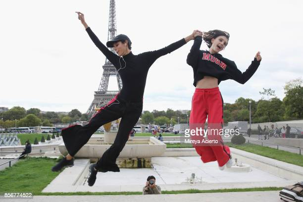 Models Dilone and Anna Hagood seen during Paris Fashion Week Womenswear Spring/Summer 2018 on October 2 2017 in Paris France