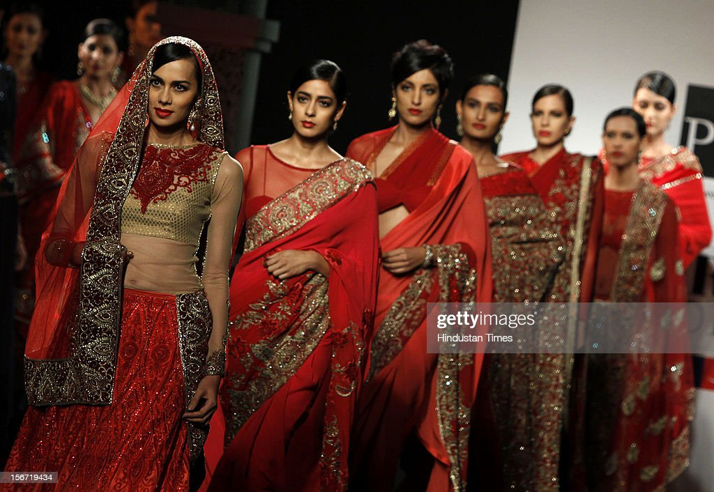'NEW DELHI,INDIA -AUGUST 8: Models display a creation of designer Varun Bahl at the PCJ Delhi Couture week 2012 in New Delhi,India. (Photo by M Zhazo/Hindustan Times via Getty Images)'